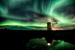 Lighthouse And Aurora-Filled Sky, Iceland Copyright: Gunnar Gestur